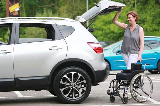 Customer-with-wheelchair-opening-boot-of-Motability-car