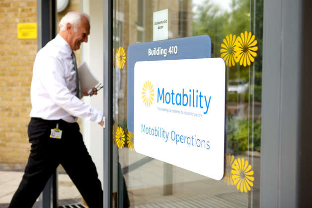 Motability Operations employee enters Bristol Office