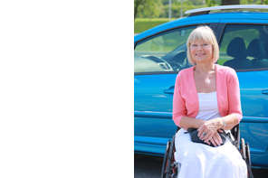 Lady-in-wheelchair-in-front-of-blue-car