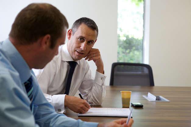 Discussion between two Motability Operations employees in meeting room